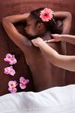 Woman receiving shoulder massage at spa Royalty Free Stock Image