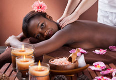 Woman Receiving Shoulder Massage At Spa Stock Photography