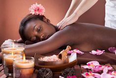 Woman receiving shoulder massage at spa Stock Photo