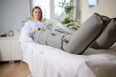 Woman receiving slimming lymphatic drainage treatment at beautic Stock Photography