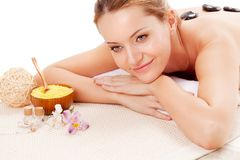 Woman receiving spa stones therapy Royalty Free Stock Photo