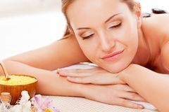 Woman receiving spa stones therapy Stock Photos