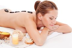 Woman receiving spa stones therapy Stock Images