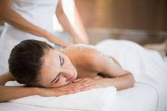 Woman receiving spa treatment from female masseur Royalty Free Stock Images