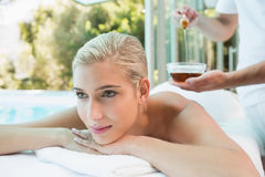 Woman receiving spa treatment with honey Stock Photos
