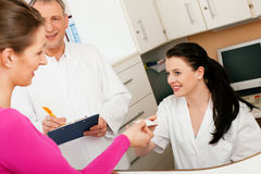 Woman at reception of clinic Royalty Free Stock Images