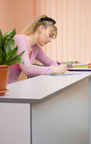 Woman receptionist write a note Royalty Free Stock Images