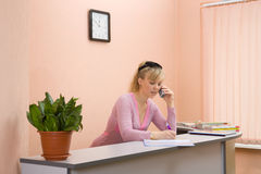 Woman receptionist write a note stock photos
