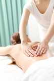 Woman receves back massage Royalty Free Stock Images