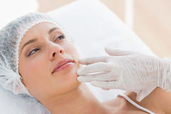 Woman recieving botox injection Royalty Free Stock Photo