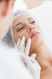Woman recieving botox injection in upper lip Stock Photo