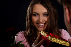 Woman recieving a gift. Stock Photography