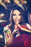 Woman recieving a gift. Royalty Free Stock Photos
