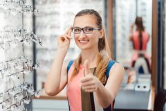 Woman recommending buying new eyewear stock images