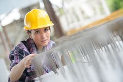 Woman recording and accounting metal profiles in stock Royalty Free Stock Photo