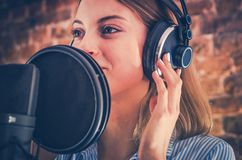 Woman Recording Audiobook. Audio Recording Studio Theme. Caucasian Voice Talent Stock Photo