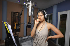 Woman recording mucis in a studio Stock Image