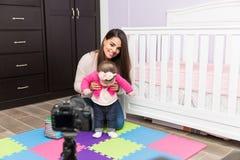 Woman recording parenting video blog Stock Photo
