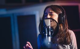 Woman recording a song for her new album Royalty Free Stock Photography