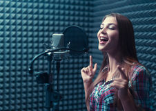 Woman in a recording studio. Singing girl in recording studio royalty free stock photo