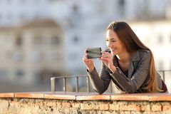 Woman recording video or taking photos with phone stock photo