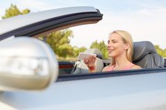Woman recording voice on smartphone at car. Road trip, technology and communication concept - happy young woman calling on smartphone or using voice command stock photos