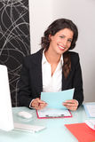 Woman in recruitment firm. Female recrutemant consultant sat at desk Stock Image