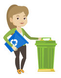 Woman with recycle bin and trash can. Stock Image