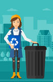 Woman with recycle bins. Royalty Free Stock Image