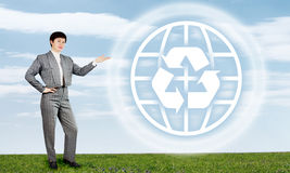 Woman And Recycle Sign Royalty Free Stock Images