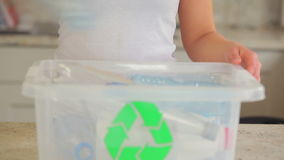 Woman recycling bottles stock video