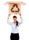Woman with a recycling box Stock Photography