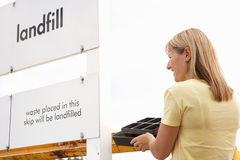 Woman At Recycling Centre Royalty Free Stock Image