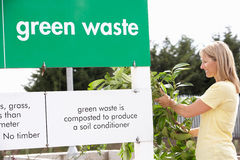 Woman At Recycling Centre. Royalty Free Stock Images