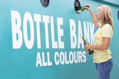 Woman At Recycling Centre  At Bottle Bank Stock Photo