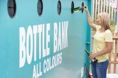 Woman At Recycling Centre  At Bottle Bank Royalty Free Stock Photo