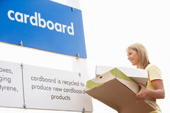 Woman At Recycling Centre Disposing Of Cardboard Stock Photos