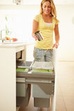 Woman Recycling Kitchen Waste In Bin. Holding Metal Can Stock Image