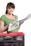 Woman recycling newspapers Royalty Free Stock Photo
