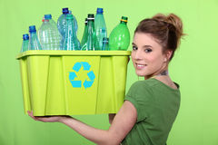 Woman recycling plastic bottles. Woman recycling crate of plastic bottles Stock Photos