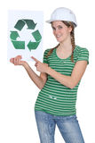 Woman with recycling poster. Woman with helmet and recycling poster royalty free stock photos