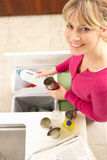 Woman Recyling Waste At Home Stock Photo