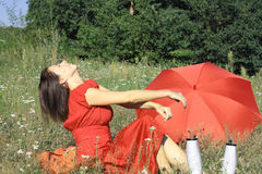 Woman in red. On meadow Stock Images