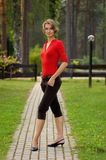 Woman in red. Girl in red shirt and short pants Stock Images