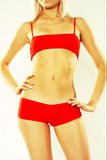 Woman In Red Active Wear Royalty Free Stock Photography