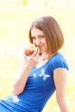 Woman with red apple Royalty Free Stock Image