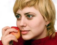 Woman with red apple Royalty Free Stock Images