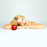 Woman and red apple Stock Images