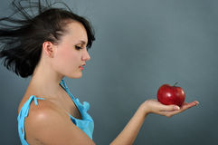 Woman with red apple Stock Image