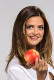 Woman with red apple Stock Photos